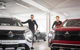 Verkopers Stephan Prins (l) en Jelmer Jubbega (r). Autobedrijf Herman Jubbega in Meppel heeft twee nieuwe auto's in de showroom staan.